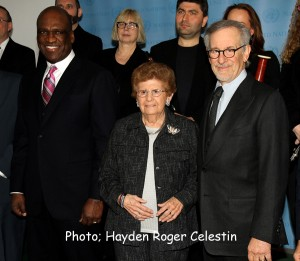 """L-to-R, Mr. John W. Ashe of Antigua and Barbuda, and President of the General Assembly's sixty-eighth session, pose with Holocaust survivor Ms Rena Finder, and Mr. Steven Spielberg, in a photo-up, Monday January 27, 2014, at the United Nations Headquarters, New York, before the start of the Memorial Ceremony, to mark the International Day of Commemoration in Memory of the Victims of the Holocaust on the theme """"Journey through the Holocaust."""" Photo: Hayden Roger Celestin"""