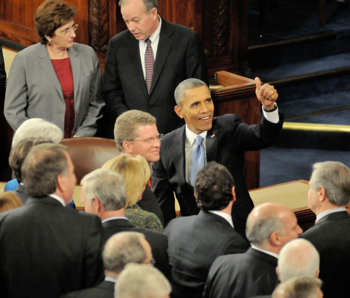 President Barack Obama, gives a thumbs- up, as he leaves the podium after giving his 6th State of the Union speech, to a Joint Session of Congress, Tuesday January 28, 2014 in Washington D.C. Photo-credit....Mario B. Cabrera / Vision Fotos