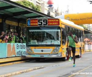 Usain Bolt runs against the Metro Bus