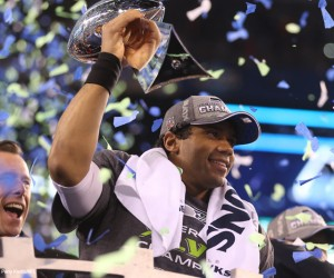 Seattle Seahawks quarterback Russell Wilson (3)  celebrates with the Lombardi Trophy after Super Bowl XLVIII at Metlife Stadium on Sunday, Feb. 2, 2014, in East Rutherford, N.J. (Ben Liebenberg/NFL)