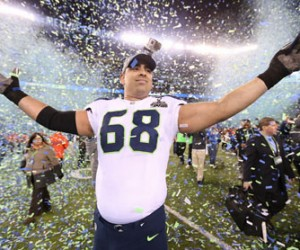 Seattle Seahawks tackle Breno Giacomini (68) celebrates after helping his team defeat the Denver Broncos in Super Bowl XLVIII at Metlife Stadium on Sunday, Feb. 2, 2014, in East Rutherford, N.J. (Ben Liebenberg/NFL)