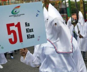 A troupe dressed in Ku Klux Klan costumes during Carnival holding a sign by the Ministry of Culture in Santo Domingo, Dominican Republic. (TWITTER)