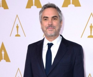 Director Alfonso Cuaron arrives at the 86th Oscars Nominees Luncheon in Beverly Hills, Calif., on Feb. 10, 2014.