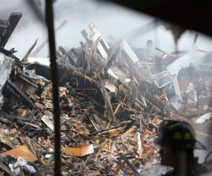 The grim search of the rubble on Park Ave. continued into Thursday, March 13, 2014. (Reuters image)