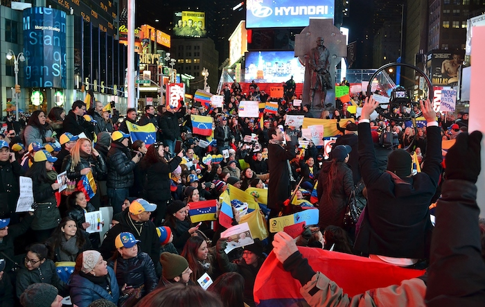 Venezuelan Americans take to Times Square to protest on behalf of their country's citizens who are fighting against President Nicolas Maduro's government.