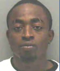 Fugitive - alleged enforcer for the Haitian street gang Zoe Pound, Wesnel Isaac.