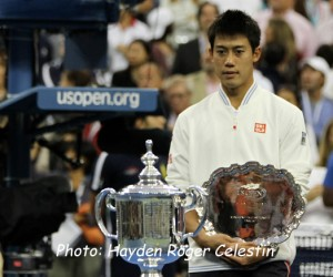 A stunned Kei Nishikori with his second place trophy after losing the U.S. Open men's final on Sept. 8, 2014.
