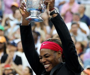 Celebration time for Serena Williams as she holds the 2014 U.S. Open trophy aloft.