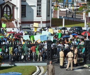 A section of Guyanese protesting against the President's decision infront of the country's parliament recently.