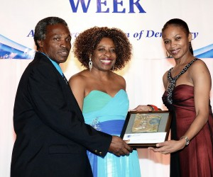 From L- Adrian Frater and Janet Silvera of The Gleaner newspaper accepting the News Journalist of the Year award for their Mario Deane series from the Jamaica Public Service Company's Ruthlyn Johnson during the annual Press Association of Jamaica Award last Friday night, Nov. 28th, in Kingston, Jamaica.  (Winston Sill/Freelance Photographer)