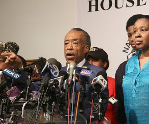 L to R., Gwen Carr, mother of Eric Garner, Reverend Al Sharpton, and Garner's son Emory addresses a press conference at the National Action Network headquarters after the grand jury returned an non indictment on Dec. 3, 2014. (Hakim Mutlaq image)