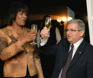 Prime Minister, Hon. Portia Simpson Miller, and Cuba's Ambassador to Jamaica, His Excellency Bernardo Guanche Hernandez toast the 56th anniversary of the Triumph of the Cuban Revolution (National Day), at a reception held at the Ambassador's residence in St. Andrew on Thursday (Jan 22), to mark occasion.