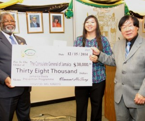 Consul General of Jamaica, Herman LaMont (left), receives donation of US$38,000 for the purchase of thermal sensing unit, from Sabrina HoSang and Vincent HoSang, Chairman of the Vincent HoSang Family Foundation (VHFF), at the Consulate in New York, on December 22. Photo Courtesy JIS Photographer
