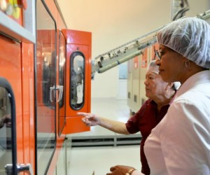 Prime Minister, the Most Hon. Portia Simpson Miller (right), and Founder and Executive Chairman, LASCO Affiliated Companies, Lascelles Chin, observe operations at LASCO Manufacturing Ltd's liquid manufacturing plant in White Marl, St. Catherine, during a tour on January 14. Picture Courtesy JIS.