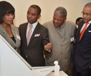 Photo by: JIS Photographer. Mr. Rodney Leon (second left), winner of the design competition, 'The Ark of Return', to be erected as a Permanent Memorial to the victims of slavery and the transatlantic slave trade at the United Nations (UN) Headquarters in New York, explains his concept to (from left), Prime Minister, the Most Hon. Portia Simpson Miller; Antiguan Prime Minister, Hon. Baldwin Spencer and Jamaica's Permanent Representative to the United Nations, Ambassador Courtenay Rattray, at on September 23 unveiling at the UN.