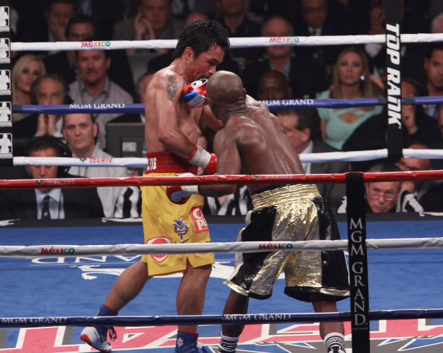 Boxers Floyd Mayweather jr and Manny Pacquiao engage each other on May 2, 2015 during their welter weight championship boxing match at MGM Grand Arena in Las Vegas. Mayweather won moving his winning record to 48 & 0. PHOTO:Marcel Thomas / MARCEL THOMAS IMAGES