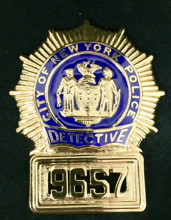 officer-holdder-now-detective