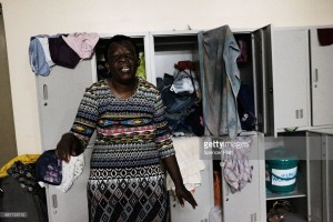 Diane Beazer, a displaced resident from the island of Barbuda, stands inside a shelter at a cricket stadium on December 7, 2017 in St John's, Antiqua. Barbuda