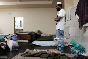 Collen Harris, a practicing Muslim and a displaced resident from the island of Barbuda, prays inside a shelter at a cricket stadium on December 7, 2017 in St John's, Antigua.