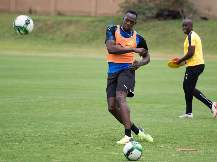 usain-bolt-tires-for-soccer-place