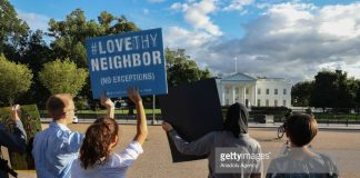 immigration-protestors-say-love-thy-neighbours