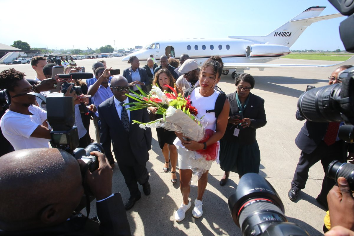 naomi-osaka-greeted-at-haiti-airport