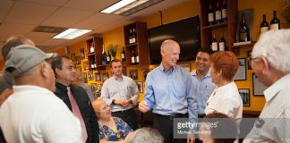 rick-scott-with-hispanic-supporters