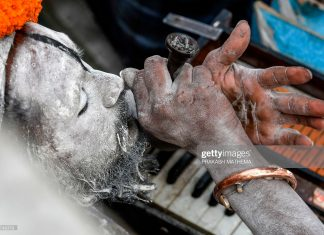 indian-sadhu-smokes-marijuana