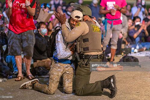 police-embrace-protestors