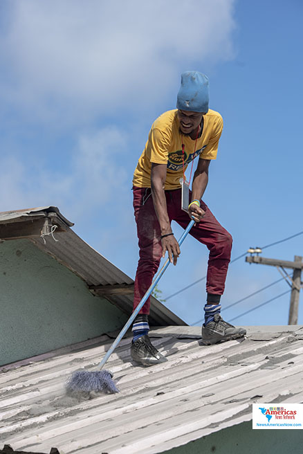 cleaning-rock-hard-ash-off-a-roof-in-owia-st-vincent